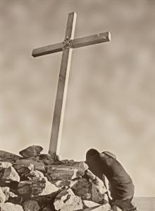 Kneeling at Cross at Rock