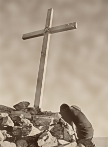 Kneeling at Cross at Rock